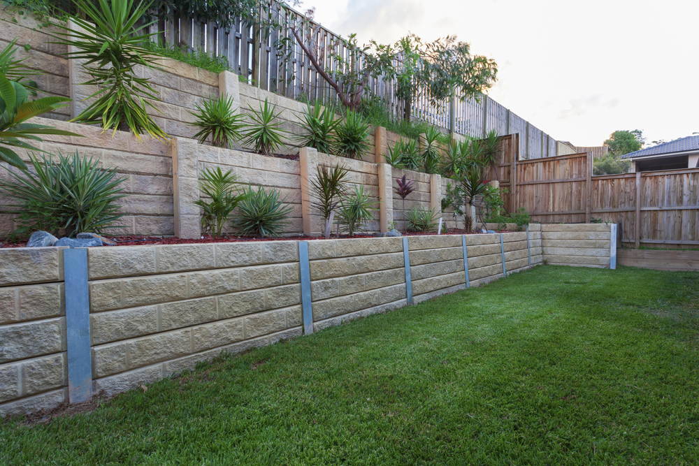 3 Reasons Your Yard Needs a Retaining Wall - Rugged Slopes ...