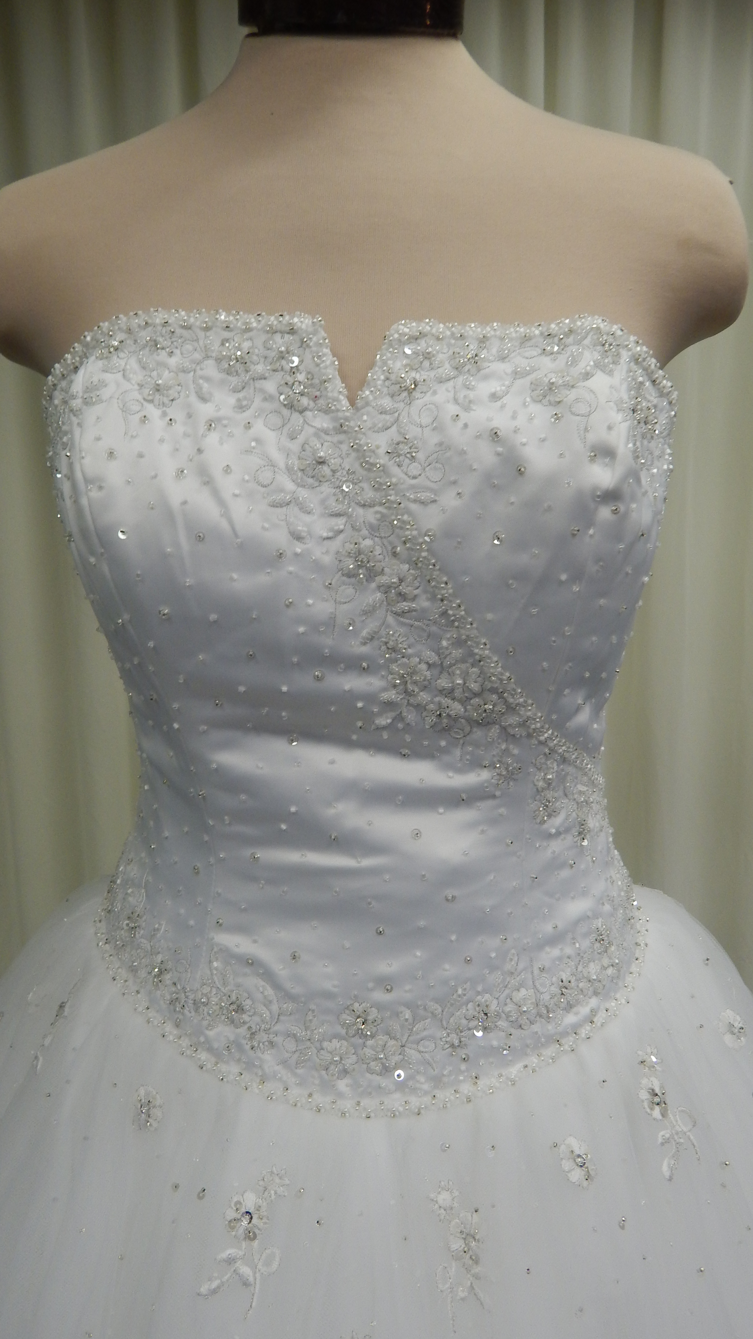 Wedding dress alterations leominster for Wedding dress tailor near me