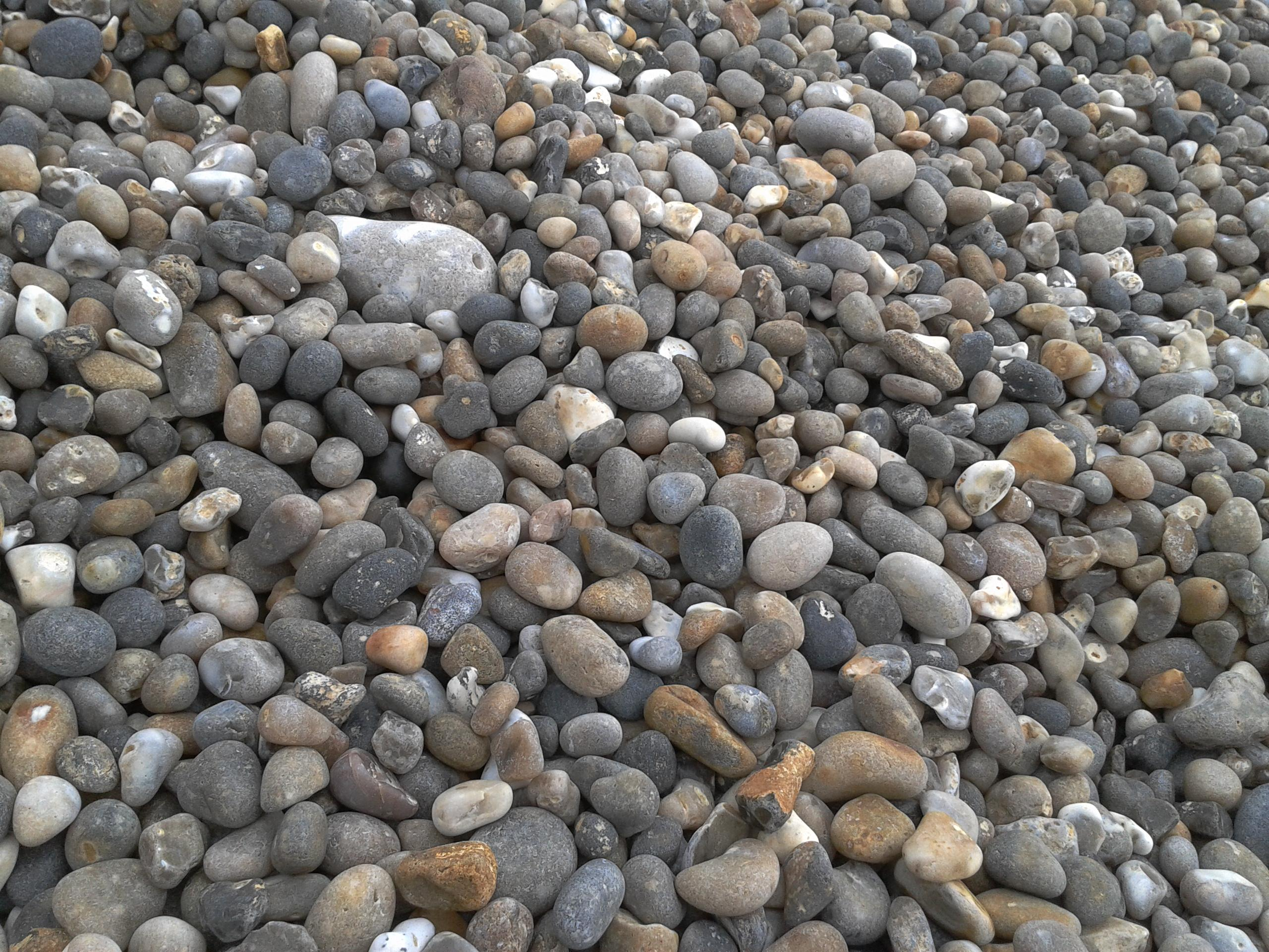 There are many types of rocks that can be used including limestone washed gravel granite and quartzite since it is such a low value material