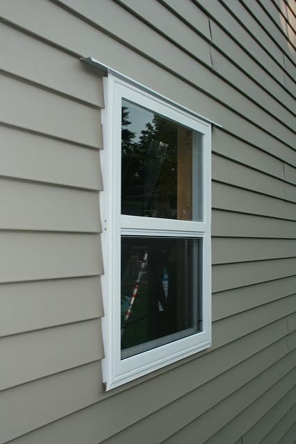 How vinyl windows improve your home s energy efficiency for Fiber cement siding vs vinyl siding cost comparison