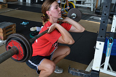 f1ddb231037e1c The Front Squat  Grab the barbell with a grip slightly wider than the with  of your shoulders