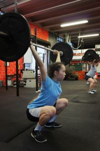 47b0c4aa5c6926 The Overhead Squat  Press the barbell overhead and then perform a squat. It  is very important that you keep your center of gravity here.