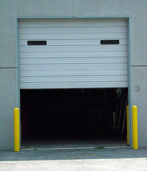 St louis door experts explain 4 types of commercial for Garage door repair st louis mo
