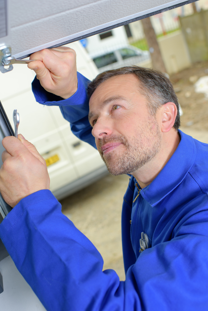 Garage door installation why hiring a professional is the for Garage service professionals
