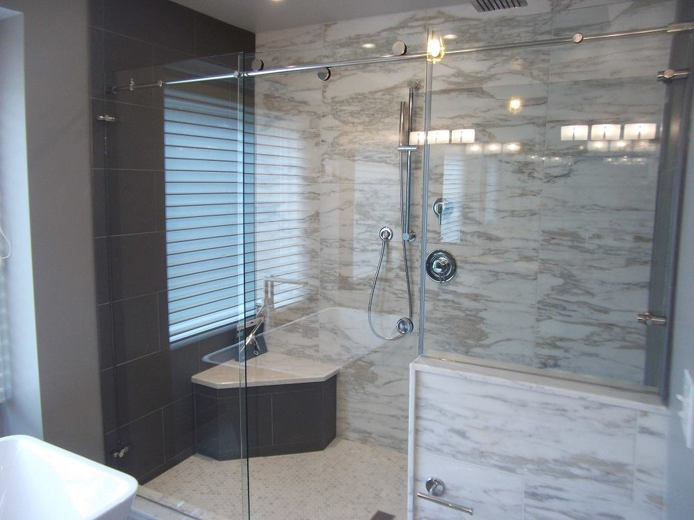 3 tips for maintaining glass shower doors hudson glass mirror its extremely effective at removing hard water stains dirt soap scum and calcium deposits from your glass shower doors planetlyrics Images