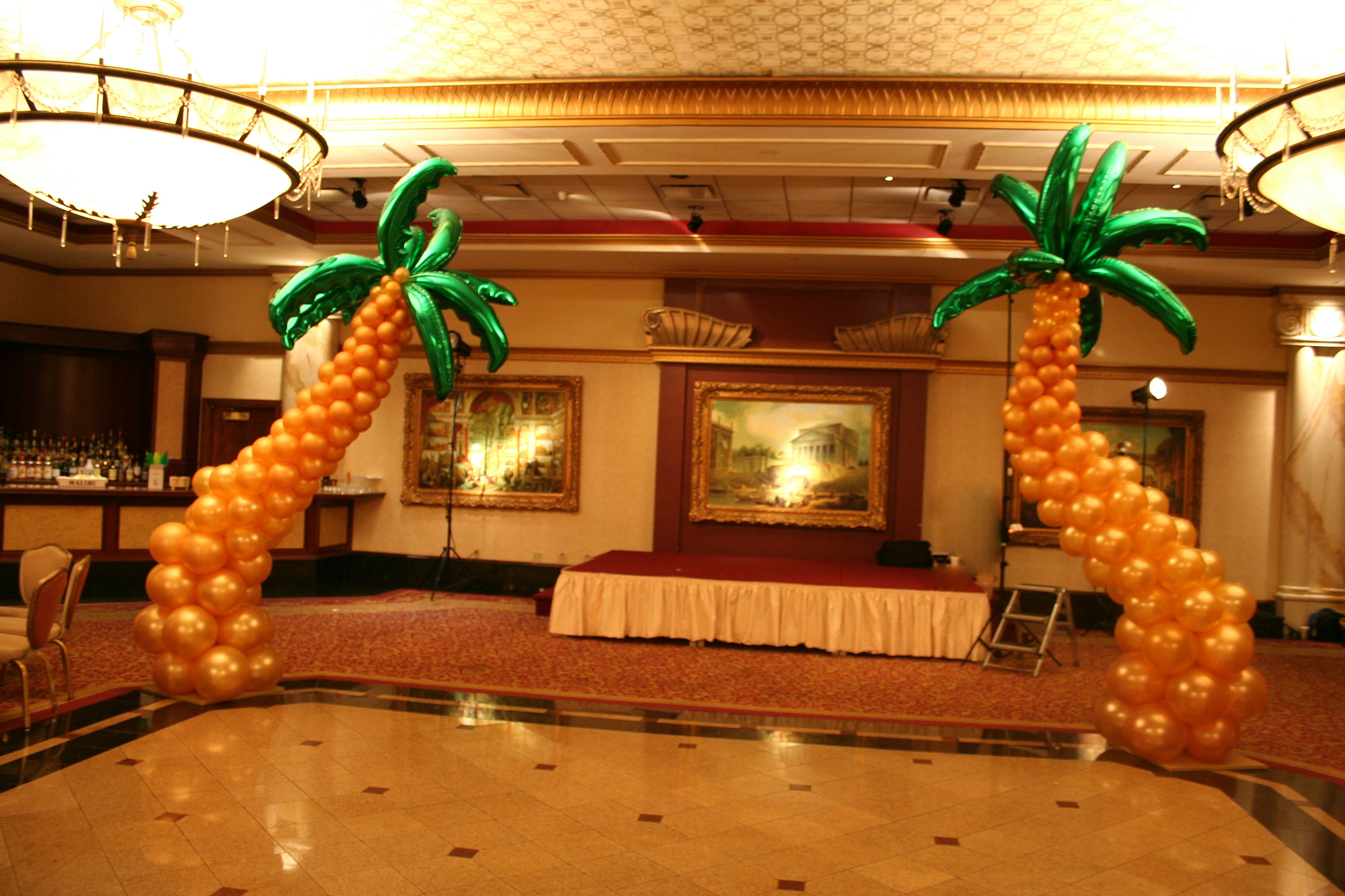 Make summer shindigs pop with dazzling balloon decorations for Palm tree decorations for the home