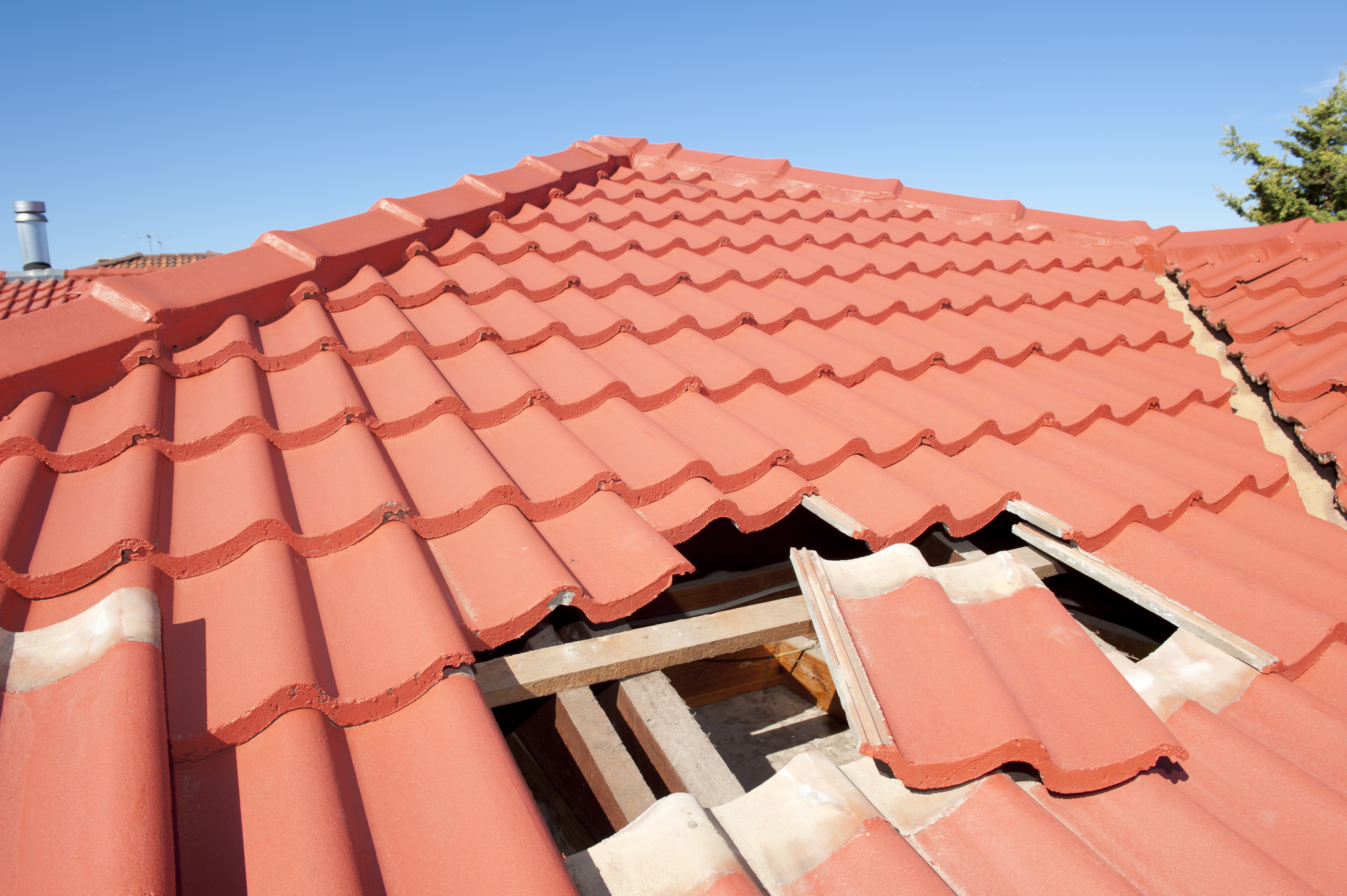 metal roofing company explains different types of roof tiles bowser