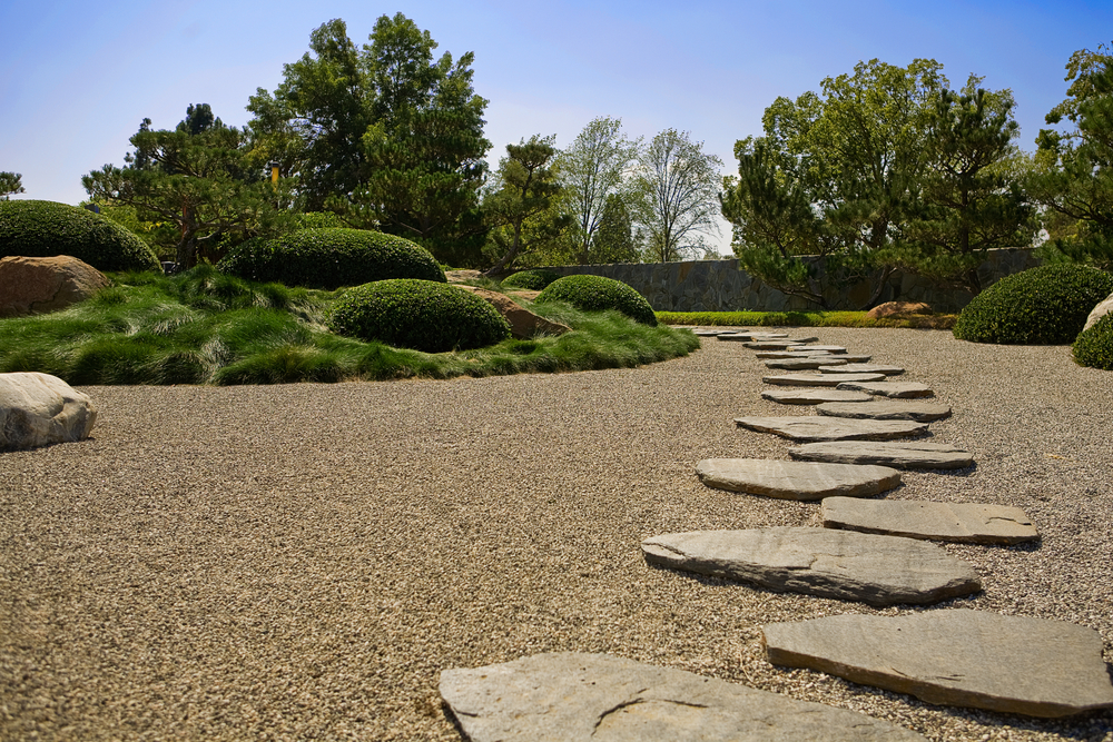 Stepping Stones Pathway: A beautiful stone pathway can add sophistication  and charm to any property's landscape. Create one using gravel to stabilize  the ... - 3 Ways To Use Gravel & Sand In Your Landscaping - LaSalle Sand
