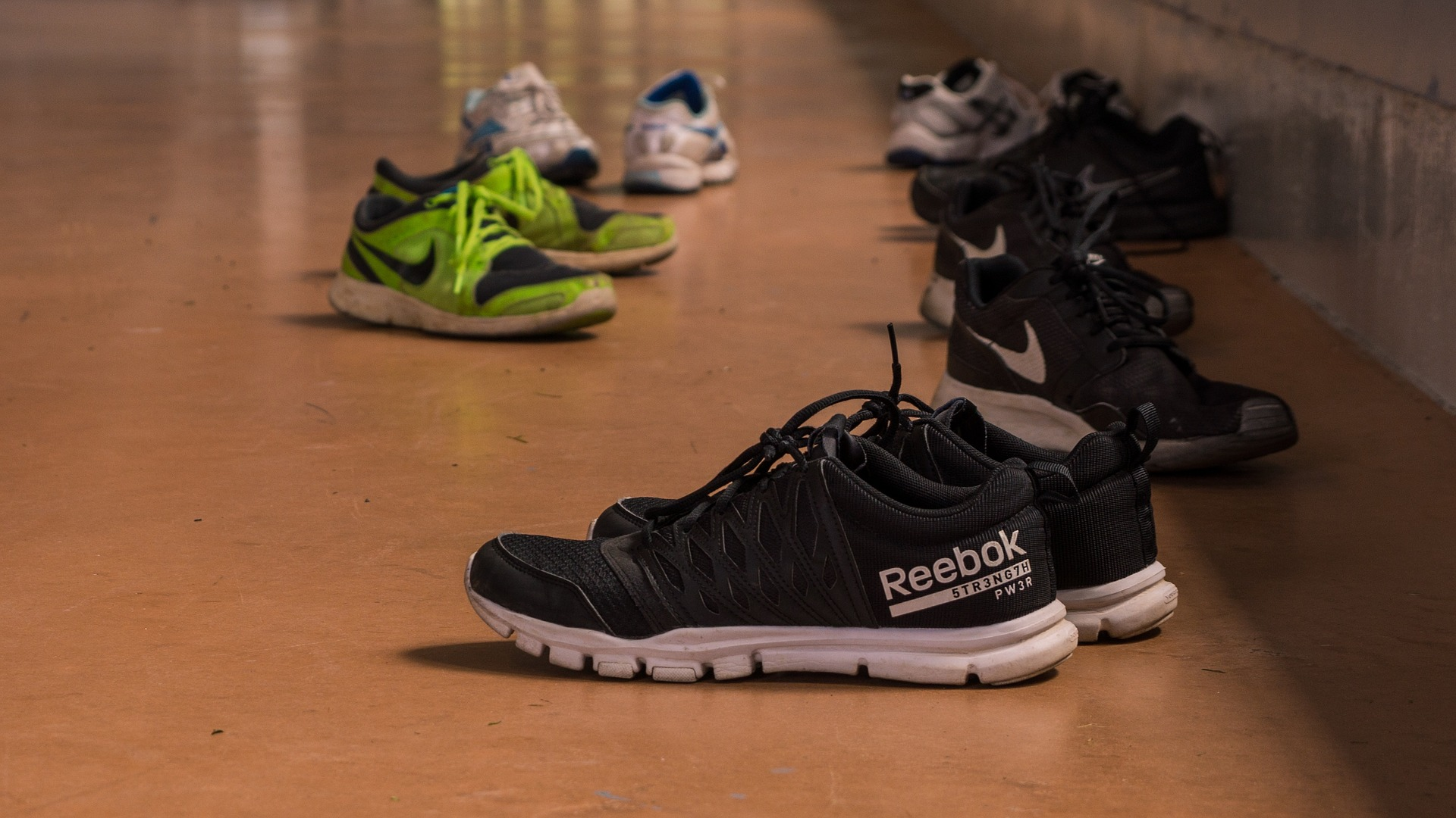 What is the importance of wearing sneakers in gym?