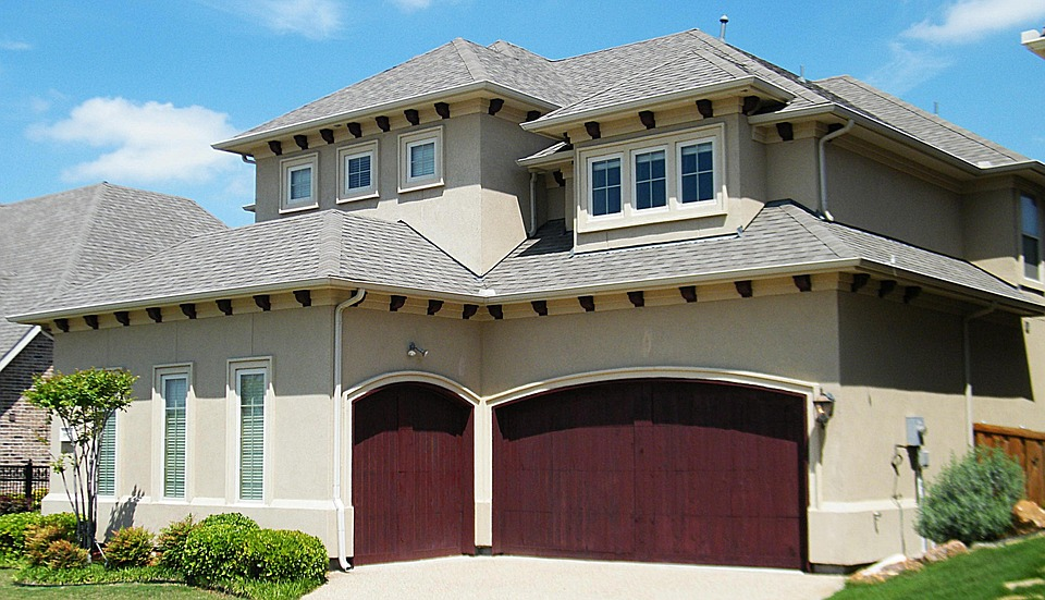 Tips on sealing your driveway from chisagos best garage door garage door solutioingenieria Choice Image